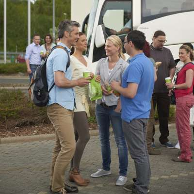 Guests enjoying food and drinks outside bus